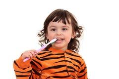 Muchacha y cepillo de dientes Foto de archivo libre de regalías