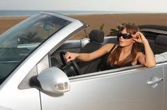 Muchacha y coche Imagen de archivo libre de regalías