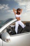 Muchacha y coche Fotografía de archivo libre de regalías