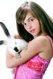 Muchacha y conejo Fotografía de archivo