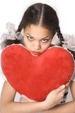 Muchacha y corazón rojo Fotos de archivo