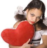 Muchacha y corazón rojo Imagenes de archivo