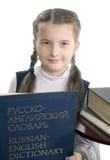 Muchacha y diccionario ruso-inglés Fotos de archivo libres de regalías