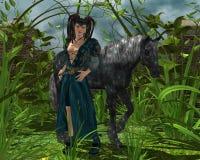 Muchacha y el caballo negro Fotografía de archivo