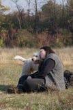 Muchacha y el perro Foto de archivo