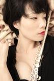 Muchacha y flauta Imagen de archivo libre de regalías