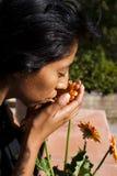 Muchacha y flor Foto de archivo libre de regalías