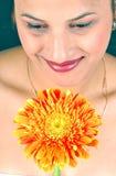 Muchacha y flor Foto de archivo