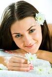 Muchacha y flores Foto de archivo libre de regalías