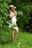 Muchacha y flores hermosas Fotografía de archivo libre de regalías