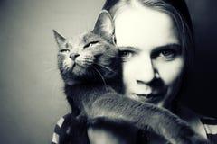 Muchacha y gato Foto de archivo
