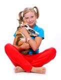 Muchacha y gato. Fotos de archivo