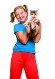 Muchacha y gato. Imagenes de archivo