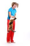 Muchacha y gato. Imagen de archivo libre de regalías