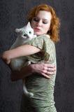 Muchacha y gato Imagenes de archivo