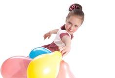 Muchacha y globos imagen de archivo