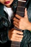 Muchacha y guitarra Fotografía de archivo