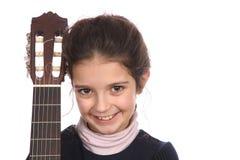 Muchacha y guitarra Fotografía de archivo libre de regalías