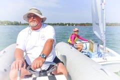 Muchacha y hombre en el barco Imagen de archivo