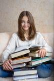 Muchacha y libros Fotos de archivo