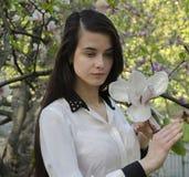 Muchacha y magnolia Imagen de archivo libre de regalías
