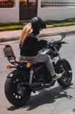Muchacha y moto Foto de archivo