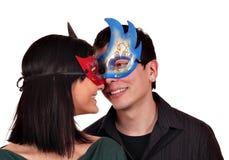 Muchacha y muchacho con la máscara Imagen de archivo
