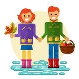Muchacha y muchacho con las hojas y la cesta Fotografía de archivo libre de regalías