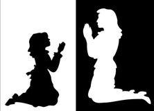 Muchacha y mujer en rezo Imágenes de archivo libres de regalías