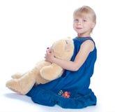 Muchacha y oso Foto de archivo libre de regalías