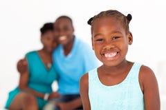 Muchacha y padres africanos Imágenes de archivo libres de regalías