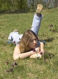 Muchacha y pasque-flores Foto de archivo libre de regalías