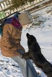 Muchacha y perro Fotografía de archivo libre de regalías