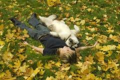 Muchacha y perro Imagenes de archivo