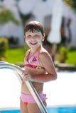 Muchacha y piscina Imagen de archivo