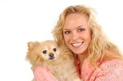 Muchacha y Pomeranian Imagen de archivo