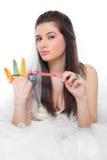 Muchacha y preservativos hermosos Fotos de archivo libres de regalías