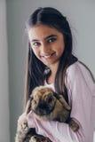 Muchacha y su conejo Foto de archivo