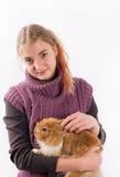 Muchacha y su conejo de pascua Fotografía de archivo