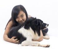 Muchacha y su perro Fotos de archivo