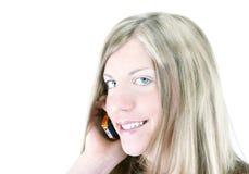 Muchacha y su teléfono Fotografía de archivo libre de regalías