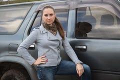 Muchacha y SUV Fotografía de archivo