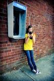 Muchacha y teléfonos Imagen de archivo libre de regalías