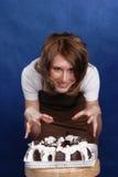 Muchacha y torta Foto de archivo