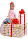 Muchacha y tres rectángulos de regalo Imagen de archivo