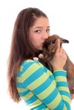 Muchacha y un conejo. Imágenes de archivo libres de regalías
