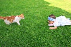 Muchacha y un gato Imagen de archivo