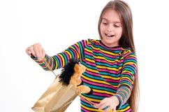 Muchacha y un juguete del caballo Foto de archivo libre de regalías
