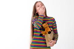 Muchacha y un juguete del caballo Fotos de archivo
