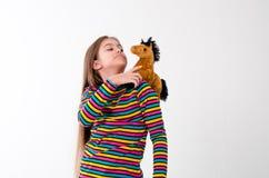 Muchacha y un juguete del caballo Imágenes de archivo libres de regalías
